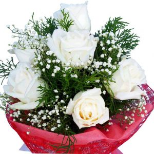 White Roses in a bouquet, close up