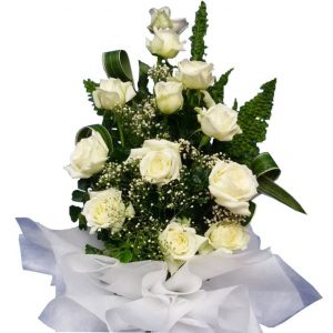 White Roses in a large tall bouquet, close up