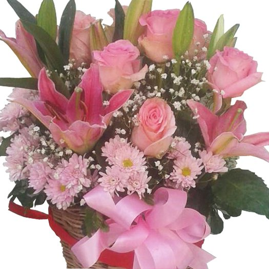 Lilies mixed with Roses & Chrysanthamums in a basket, close up