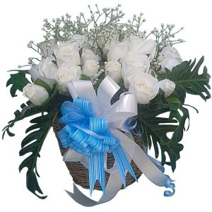 White Roses in a handmade wicker basket