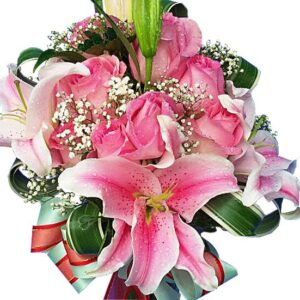 Lilies and pink Roses in a vase, close up