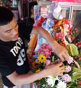 Jack working on a flower arrangement at Flowers By Jack the Koh Samui Florist