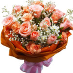 Peach Roses & Carnations in a bouquet close