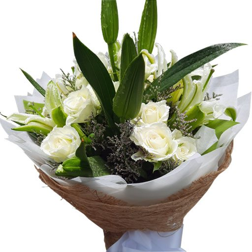 White Roses and Lilies in a bouquet close up