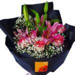 Lilies & Roses Black Wrap Bouquet close