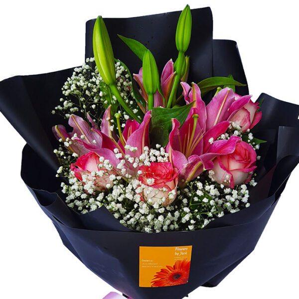Lilies & Roses Black Wrap Bouquet, close up