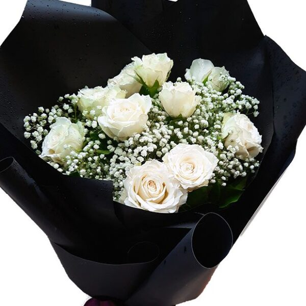 White Roses in a Black Wrap Bouquet close up
